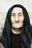 Serious elderly woman Stock Photography