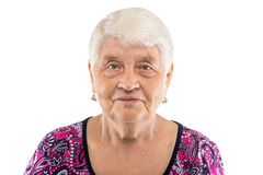 Serious elderly woman with white hair Stock Images