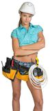 Serious electrician in helmet, shorts, shirt, tool Stock Photography