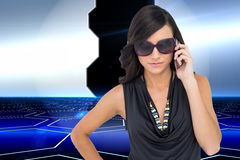 Serious elegant brunette wearing sunglasses on the phone Royalty Free Stock Photo