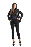Serious elegant business woman in akimbo pose with hands on her hips. Royalty Free Stock Photos