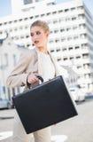 Serious elegant businesswoman holding briefcase Stock Photo