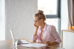 Serious elegant woman with laptop in home office. Working at home. people, business concept. close up side view photo stock photography