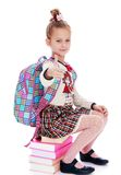 Serious, elegantly dressed schoolgirl sitting on a Stock Images