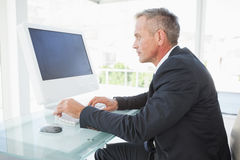 Serious employee on his pc Stock Image