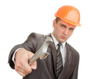 Serious engineer in hardhat with spanner Stock Photos