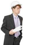 Serious engineer in helmet holds drawings in hand Royalty Free Stock Image