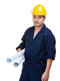 Serious engineer holding blueprint Stock Photos