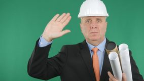Serious Engineer Make Salute Gestures with Green Screen in Background stock photos