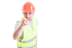 Serious engineer making looking at you gesture Royalty Free Stock Photo