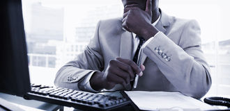 Serious entrepreneur while working with a computer Stock Photos