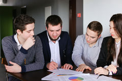 Serious entrepreneurs, young mans and woman develop plans for pr. Shooting portraits of educated employees of company, girls and three guys who pass each other`s Stock Photo