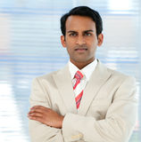 Serious ethnic businessman with folded arms Royalty Free Stock Images