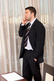 Serious executive man have a call Stock Image