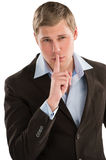 Serious executive standing with finger near his mouth - tss gest Royalty Free Stock Photos