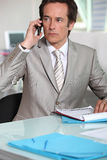 Serious executive taking call Stock Images