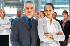 Serious executives amongst colleagues Stock Images