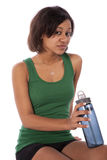 Serious expression holding water bottle Stock Photography