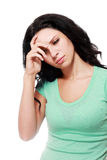 Serious expression. Young woman with serious expression leaning with her hand on hair stock photo