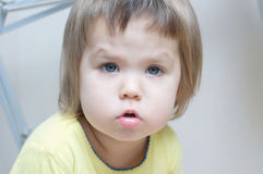 Serious face baby girl portrait talking with cute sweet cheeks Royalty Free Stock Image