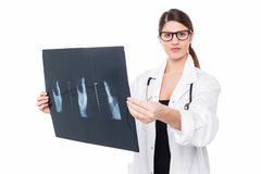 Serious faced female doctor holding up x-ray Stock Photography