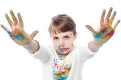 Serious faced girl with painted hands Royalty Free Stock Image