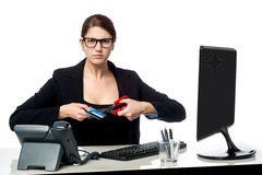 Serious faced woman cutting her credit card Stock Photos