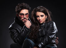 Serious fashion couple in leather jackets royalty free stock photography