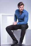 Serious fashion man sitting and looks away Royalty Free Stock Images