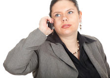 Serious fat businesswoman with mobile phone Stock Photo