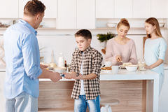 Serious father punishing his son for smoking Stock Photos