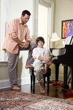 Serious father talking to teenage son at home Royalty Free Stock Images