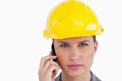 Serious female architect on her cellphone Stock Images