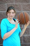 Serious female basketball player. Stock Photo
