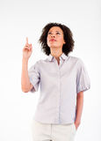 Serious female businessmanager pointing upwards Stock Photo