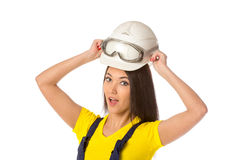 Serious female construction worker in helmet with goggles Stock Photography