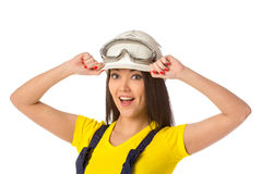 Serious female construction worker in helmet with goggles Stock Photos
