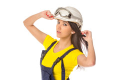 Serious female construction worker in helmet with goggles Royalty Free Stock Images