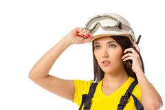 Serious female construction worker in helmet with goggles Stock Images