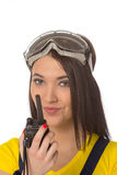 Serious female construction worker talking with a walkie talkie Stock Photography