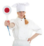 Serious female cook keeping stopping sign Royalty Free Stock Photo
