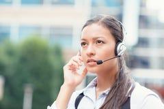 Serious female customer service representative Stock Photo