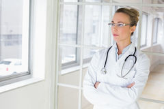 Serious female doctor with arms crossed in hospital Royalty Free Stock Images