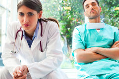 Serious female doctor with colleague in hospital Stock Images