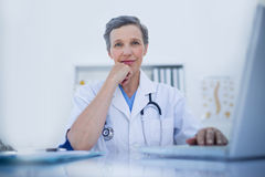 Serious female doctor looking at camera Royalty Free Stock Photo