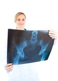Serious female doctor looking at a x-ray Royalty Free Stock Photo