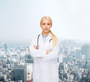 Serious female doctor with stethoscope royalty free stock photography