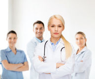 Serious female doctor with stethoscope royalty free stock image