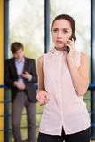 Serious female manager calling somebody Royalty Free Stock Image