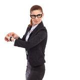 Serious female manager checking hers wristwatch. Stock Photography